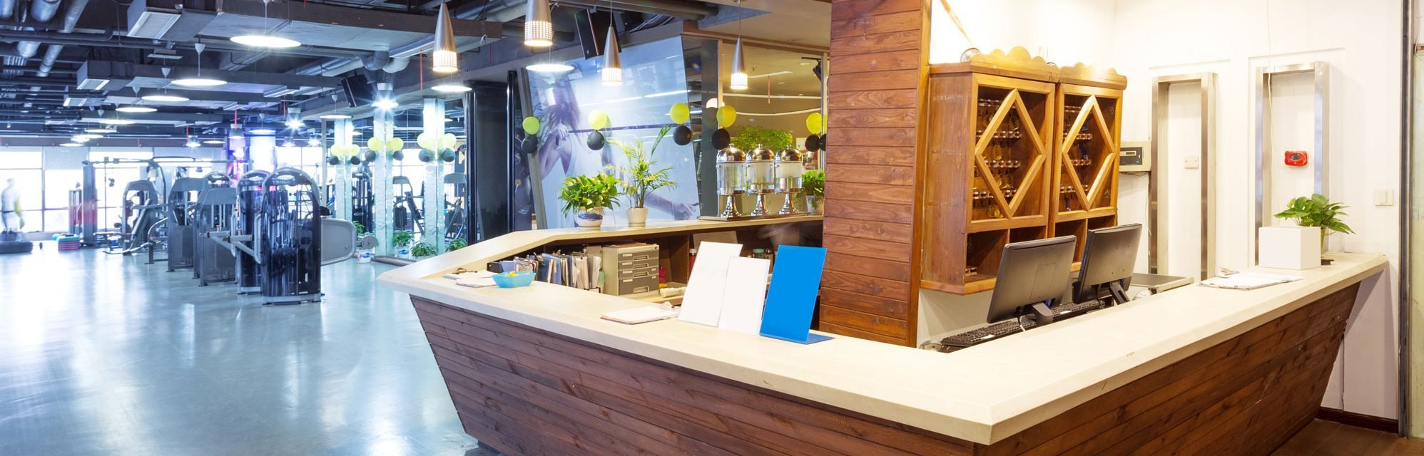 a front desk at a concept designed fitness facility